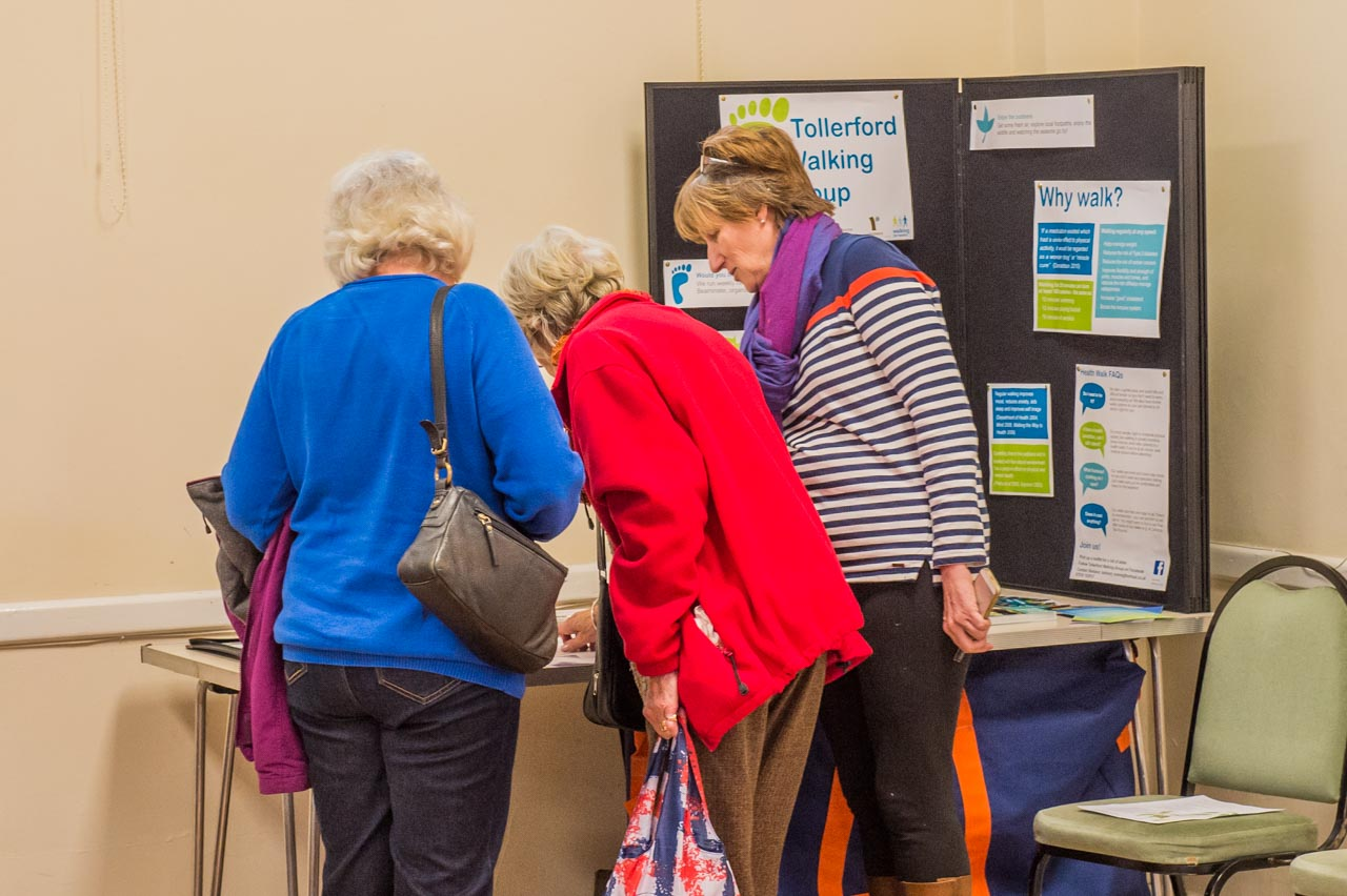 Barbara explaining Walking for Health to two interested visitors