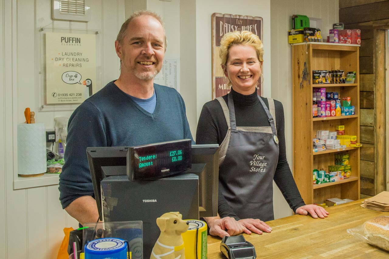 Andy and Donna behind the counter