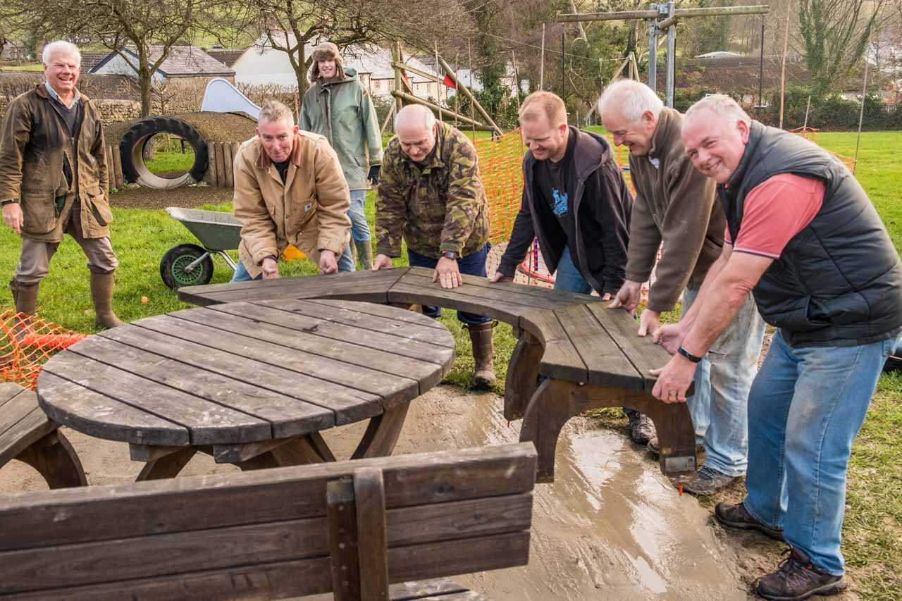 Ian, Simon, Mark, Rupert, Richard, Peter and Wayne resiting the picnic table
