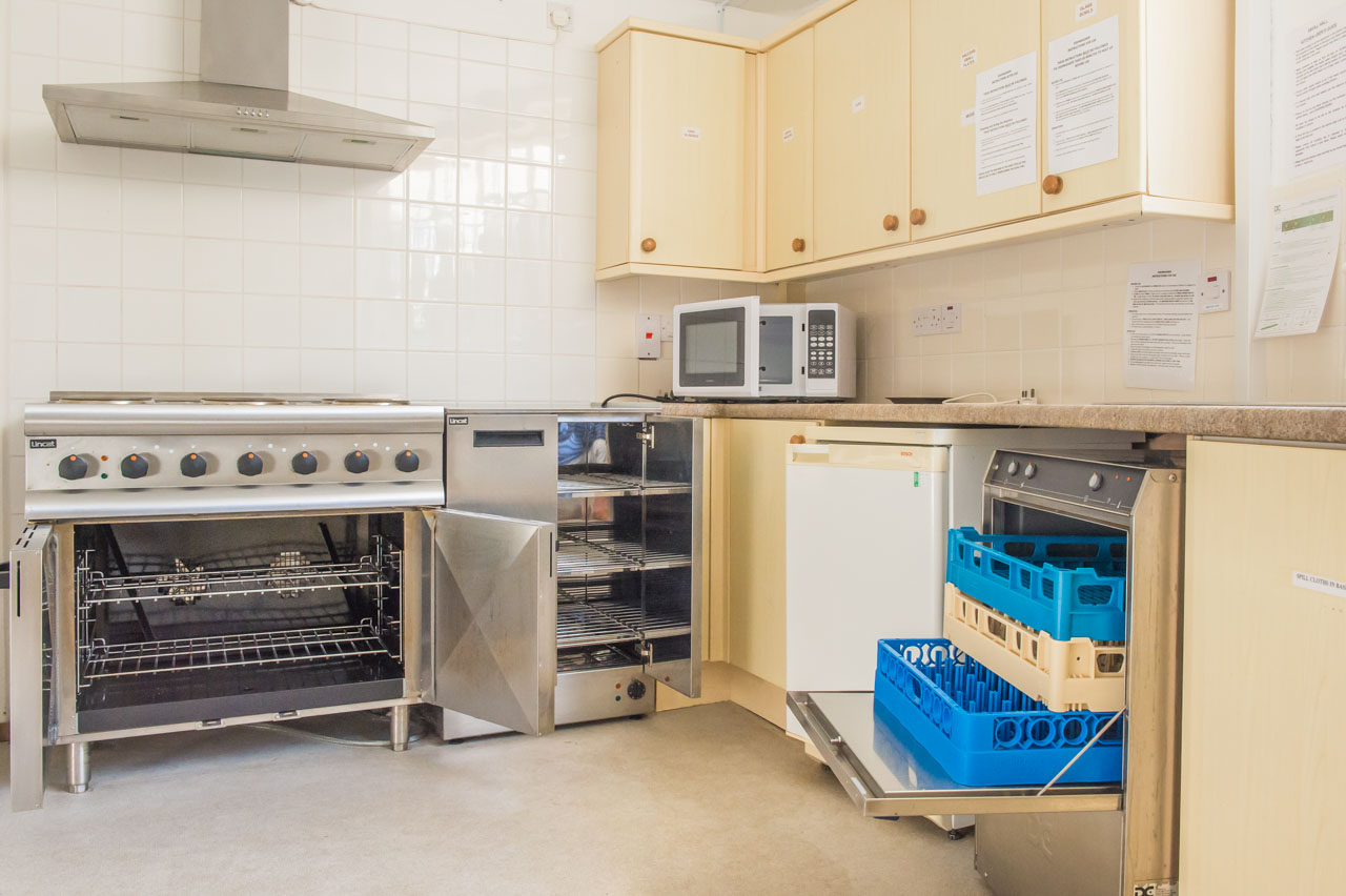 In addition to the oven and hot cupboard, there is a commercial Dishwasher, Fridge and Microwave oven