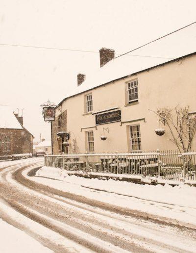 The centre of Cattistock in the snow