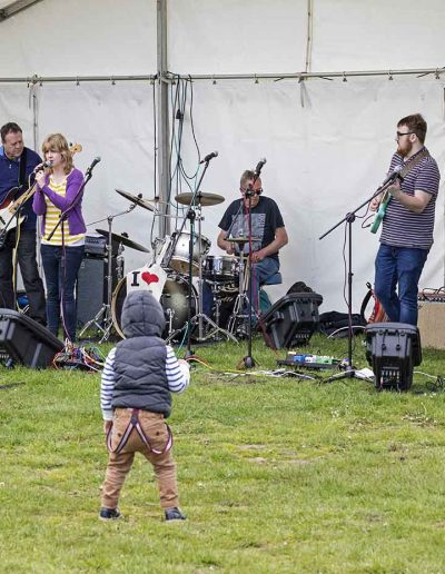 Dorset Knob Throwing 2019: A young enthusiast enjoying the band