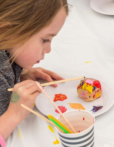 Dorset Knob Throwing 2019: A series of images of youngsters enjoying painting their own design on a Dorset Knob 1