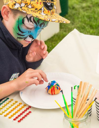 Dorset Knob Throwing 2019: A series of images of youngsters enjoying painting their own design on a Dorset Knob 2