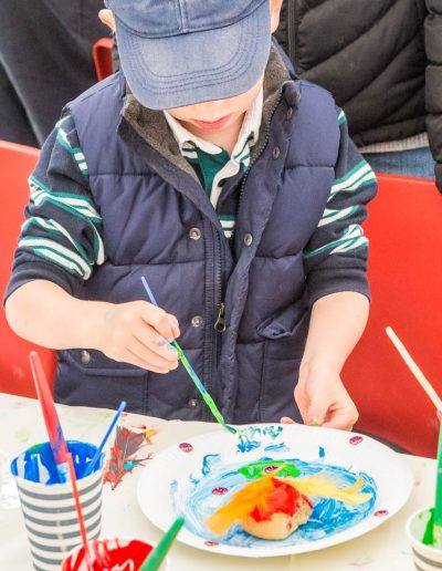 Dorset Knob Throwing 2019: A series of images of youngsters enjoying painting their own design on a Dorset Knob 7