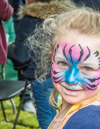 A visit to the Face Painter produces a smiling Tiger