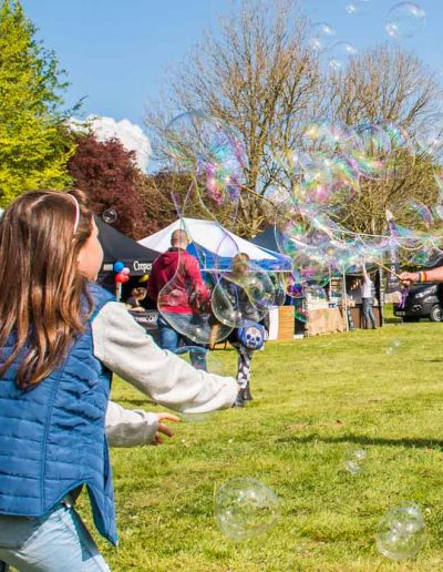 Children having fun with the bubbles