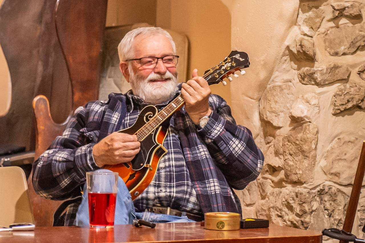 Mike playing Mandolin and enjoying a humorous moment during a Folk Club evening