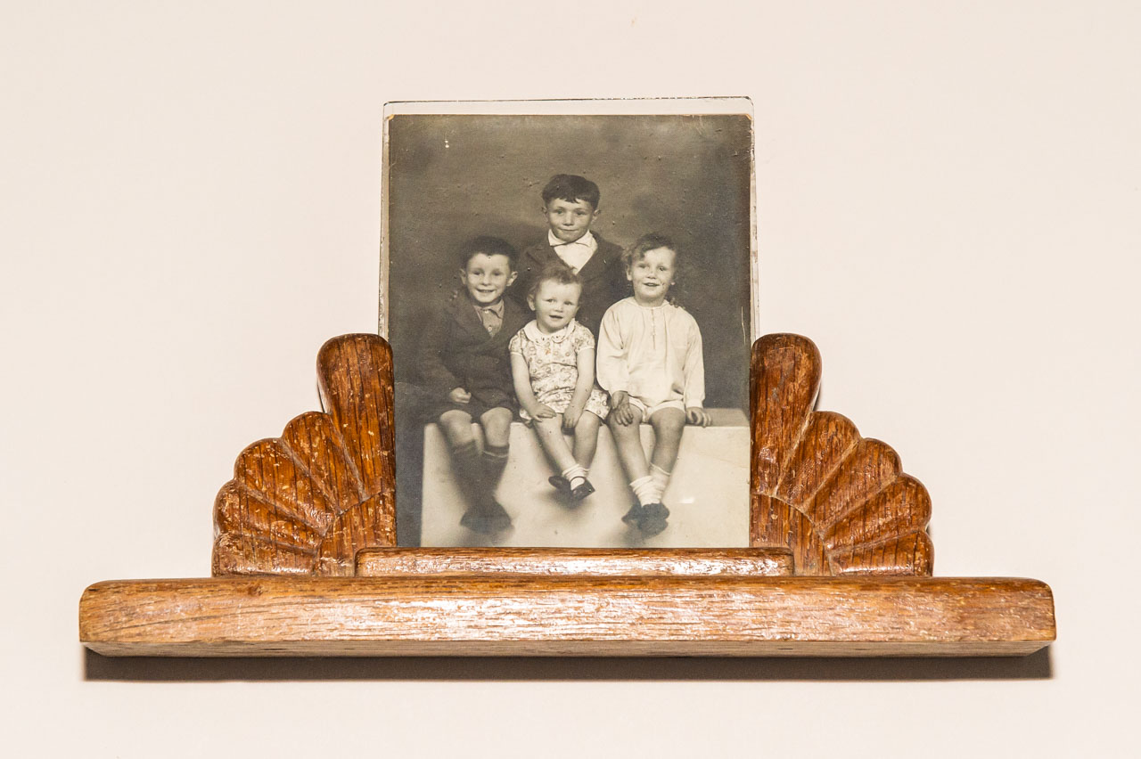 A photo, set in a frame made by a POW, of Chris, David, Eric and Mary (pre the birth of Mike)