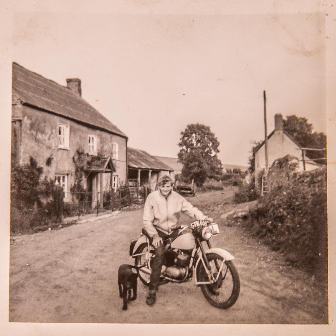 Mike aged 18 on his BSA Bantam 125, with Eric's dog Nipper alongside