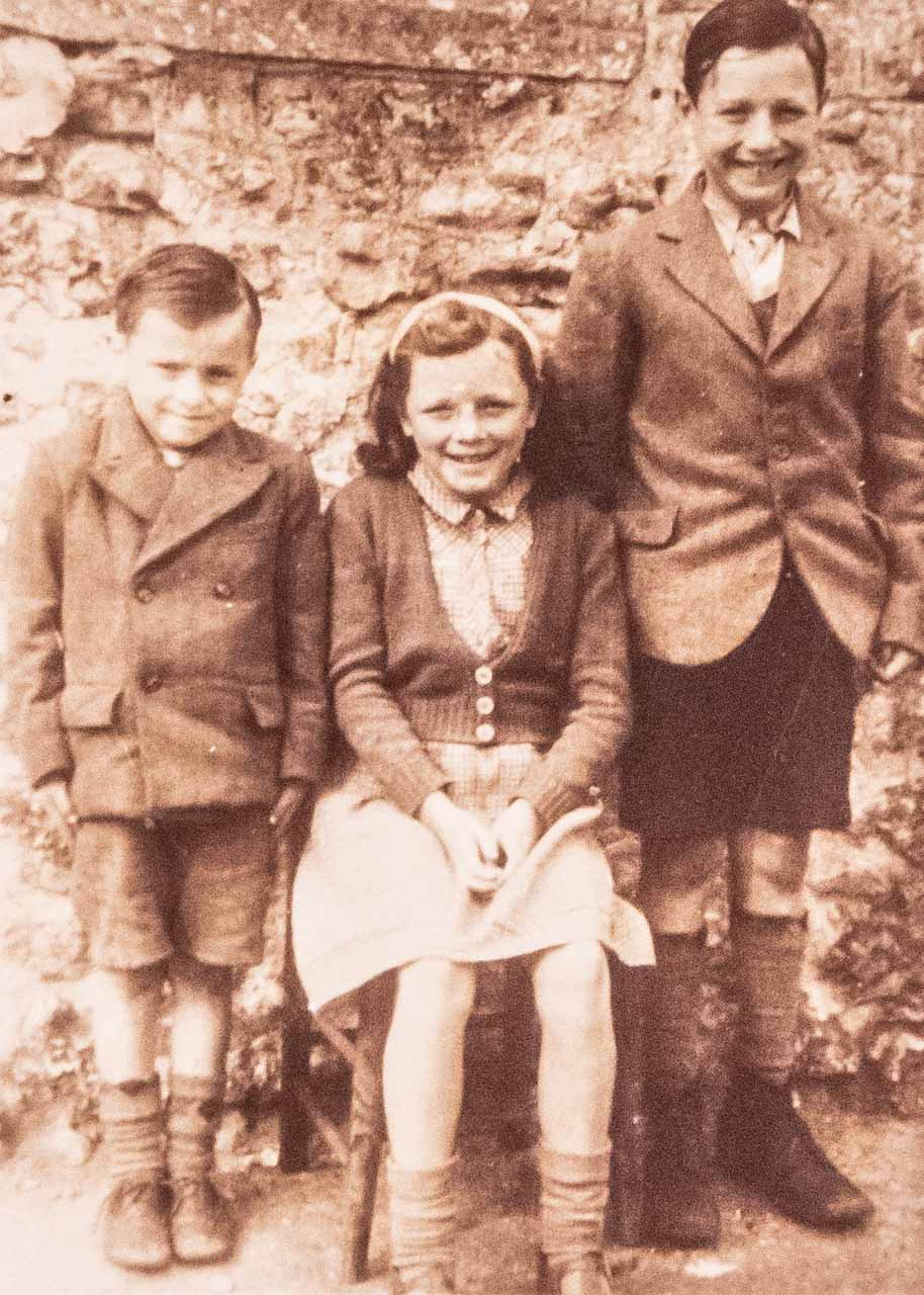 Peter, Mary and Eric, aged 13, going to the Maiden Newton Church of England school
