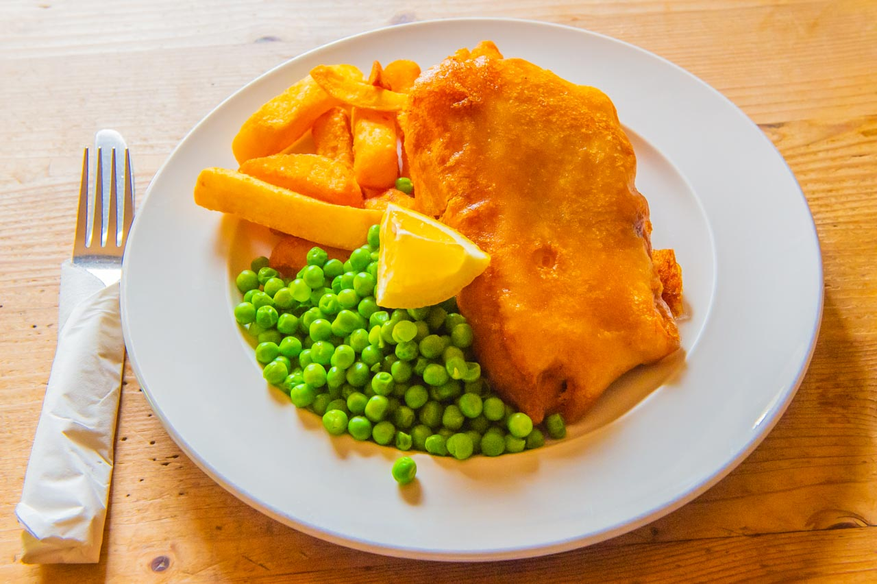 A traditional plate of Fish, Chips and Peas