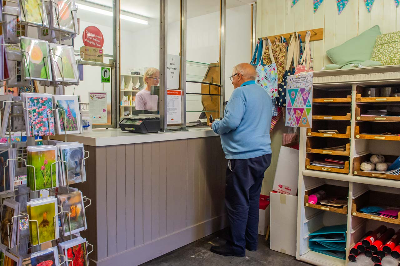 Mike being served in the village Post Office