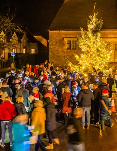 The Village Hall's Christmas tree and mulled wine and mince pies from the Fox and Hounds provide the setting for the 2019 Carol singing