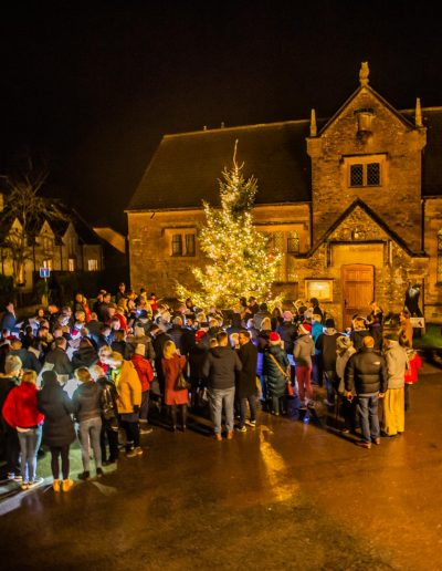Another view of villagers and visitors enjoying the carols and refreshments