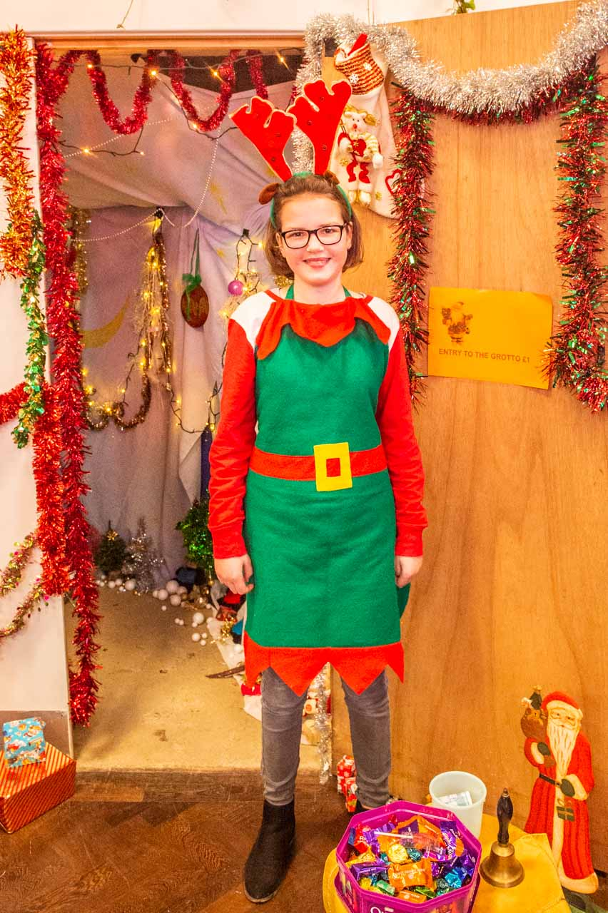 A very cheerful Elf ready to welcome all the visitors to Santa's grotto