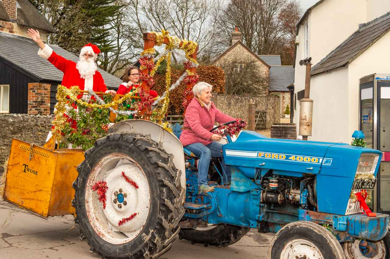 Sue drives the tractor and Santa arrives with his Elf helper