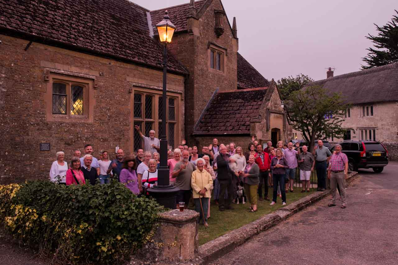 A good crowd celebrated the finished Street Lamp project - and as the darkness drew in the lamp looked more and more splendid