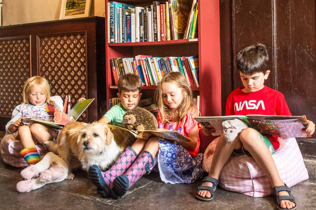 Youngsters, plus Dennis, enjoying the children's section of the library