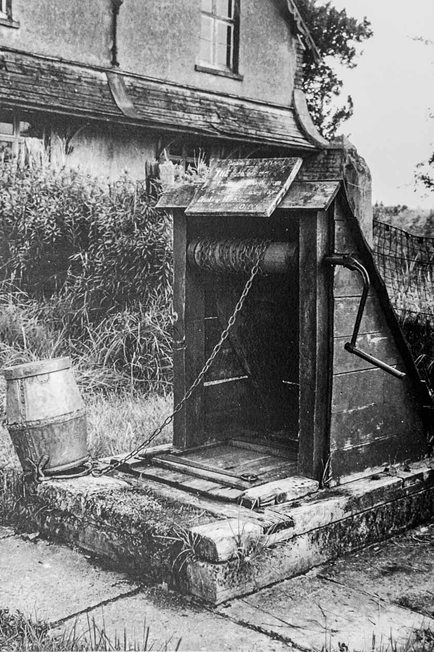 The communal well in the garden of Railway Cottages, Sandhills - and a peep of the original Railway Cottage