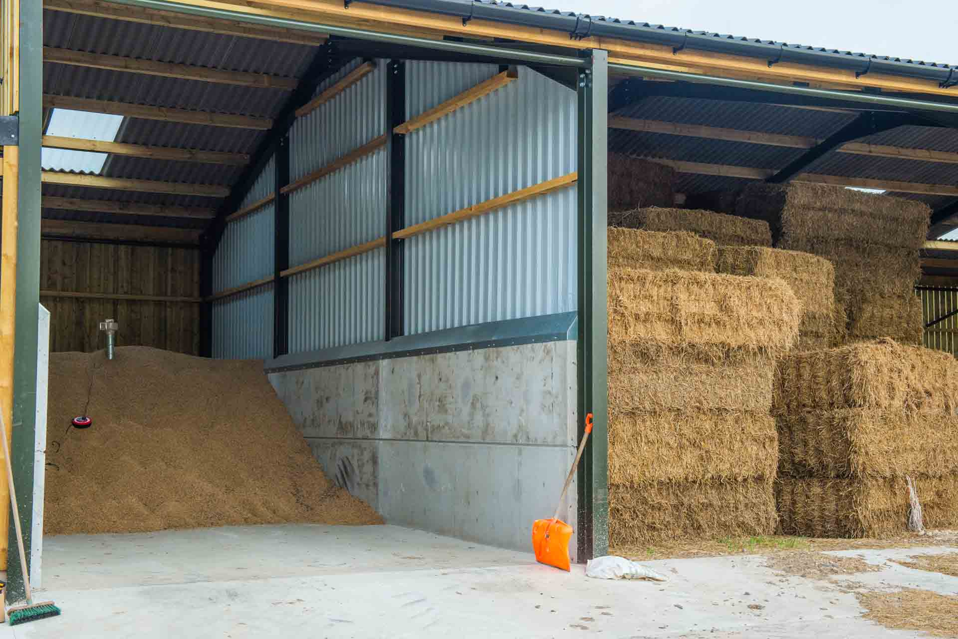 The new barn, holding rolled barley, next door to the straw