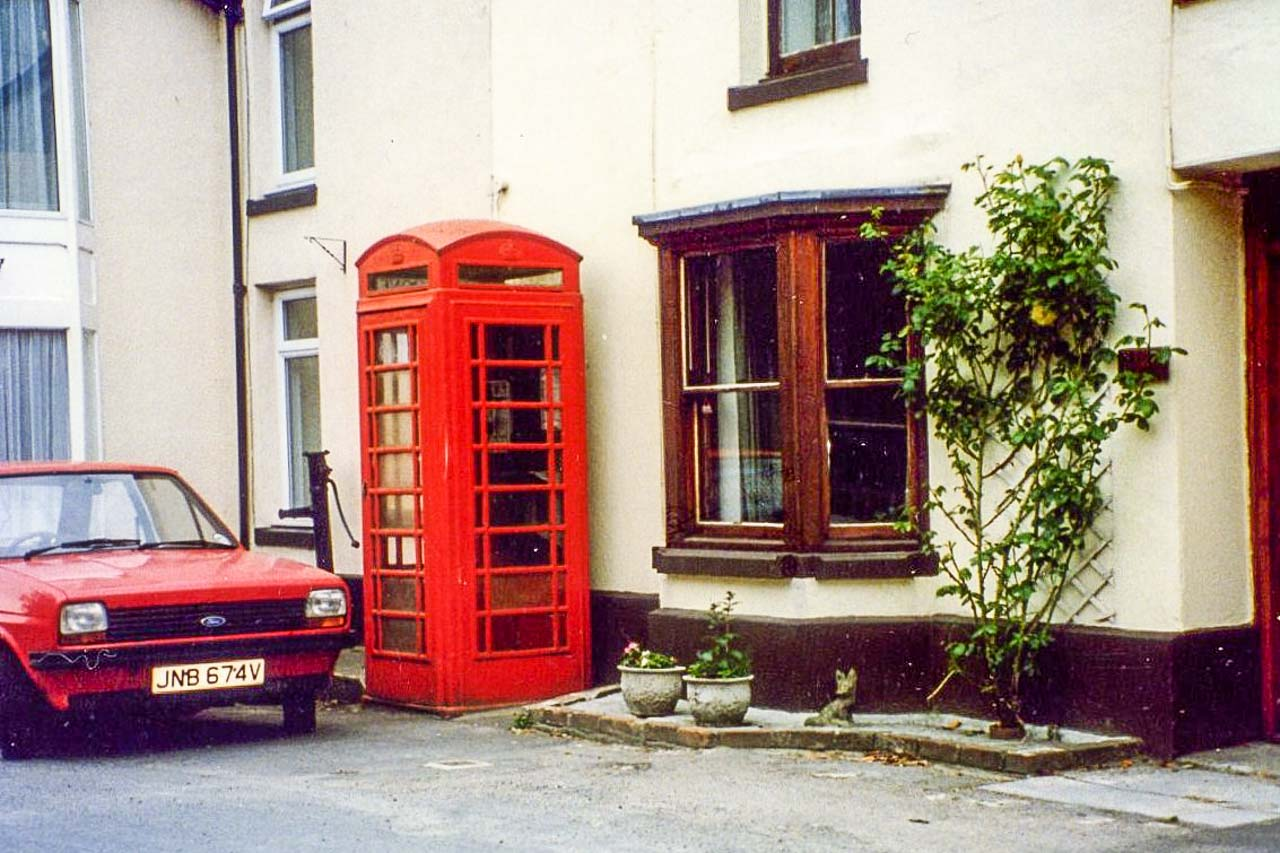 The Cattistock Phone Box when in use, complete with red Ford Escort