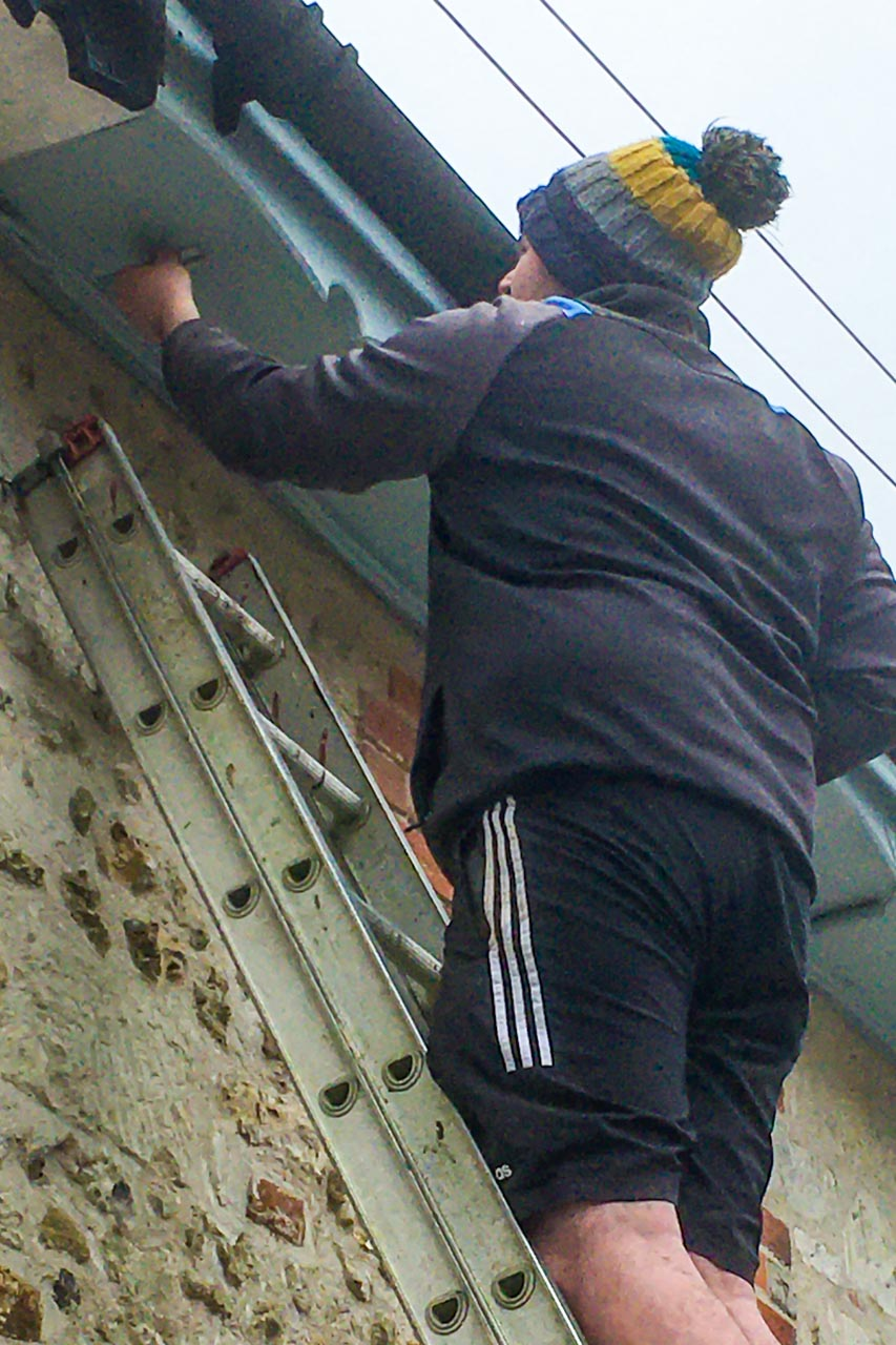 Bradley preparing to install the new man-made Housemartin nest