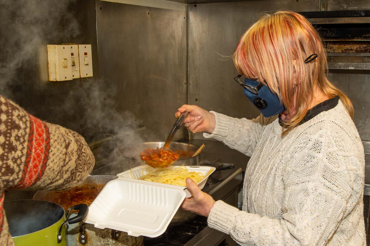 Donna ladeling some of her delicious Bolognese sauce onto the Spaghetti