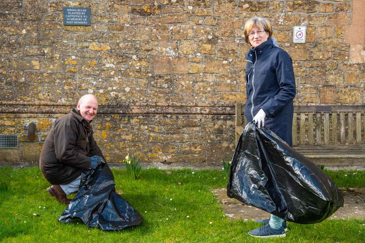Ian and Barbara checking for litter around the Savill Hall