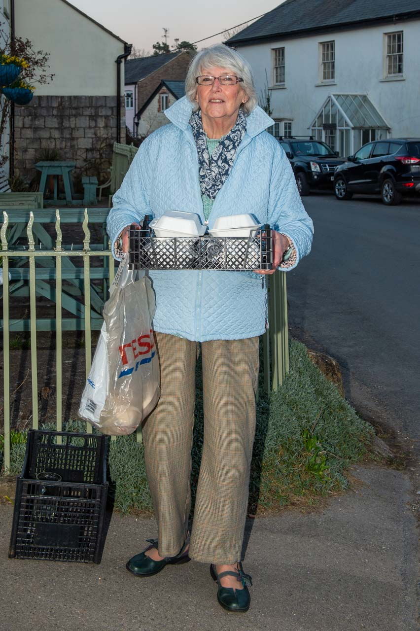 Ilene on her way with a batch of meals for Group 3