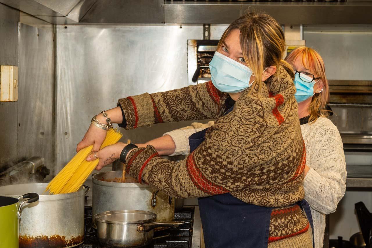 Liz and Donna preparing the Spaghetti Bolognese