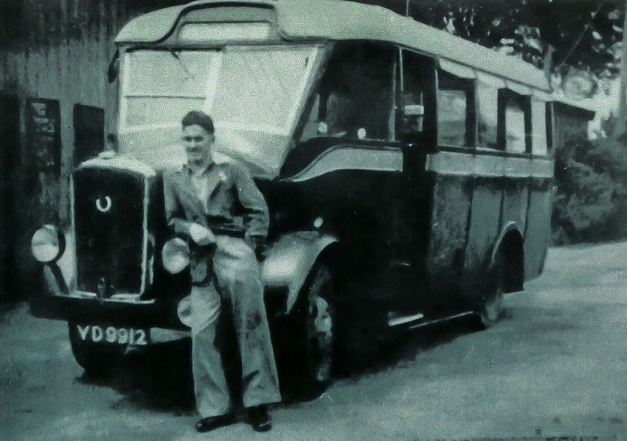 Pete Watts alongside a 'Dennis Ace' bus at Cattistock c1948