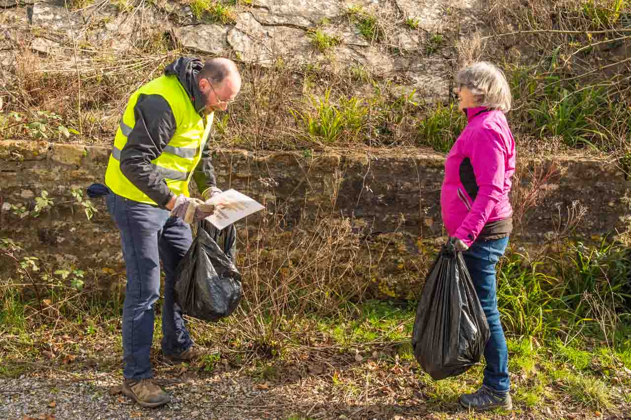Phil and Jenny finding plenty of litter in West End - all of which is read by Phil