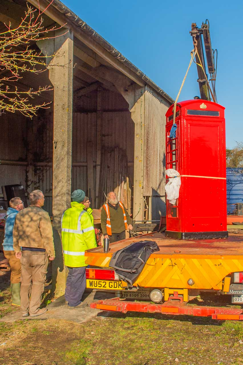 Richard succeeds in manouvering the telephone box onto the back of his recovery lorry