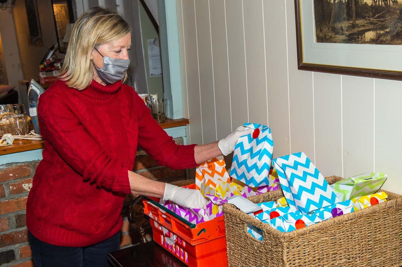 Cathy organising the bags and children's Easter cards into the 7 Groups