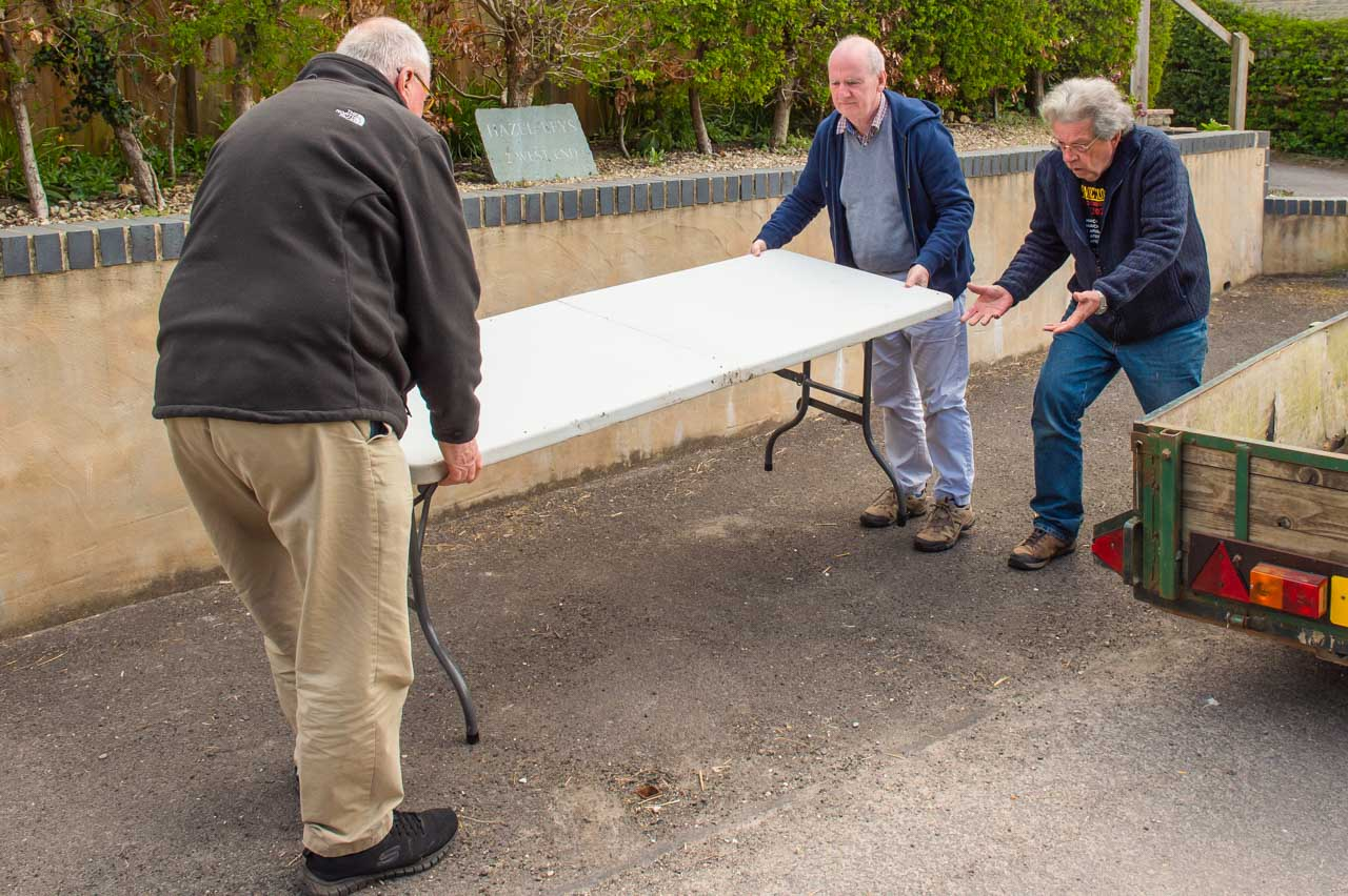 The lads setting up the group distribution points. Neil and Ian set up Group 2's table, although Phil is finding it a little difficult to keep up