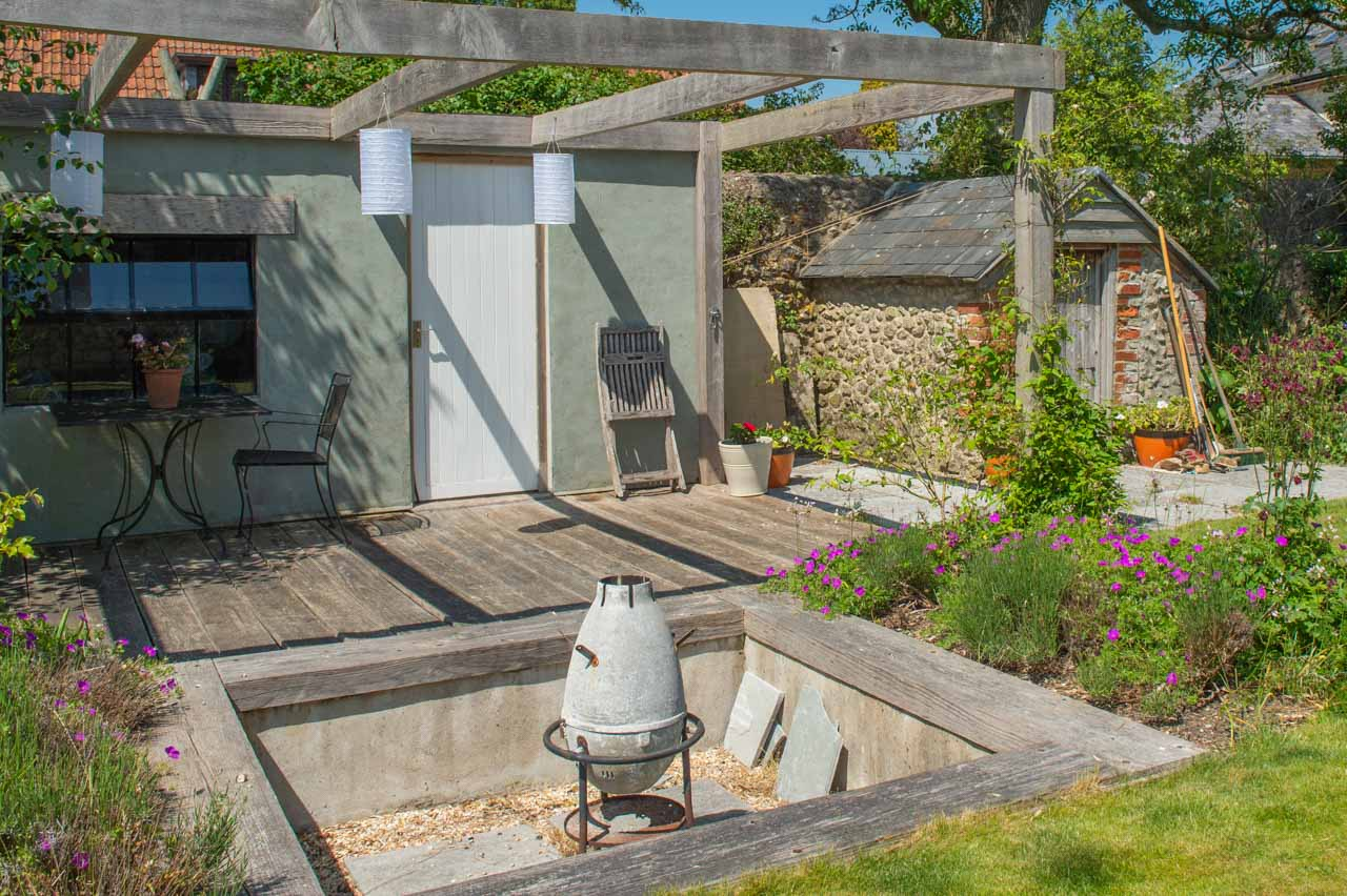 10. Georgina: A Fire Pit, paper lanterns and an old Potting shed make up another area of this varied garden