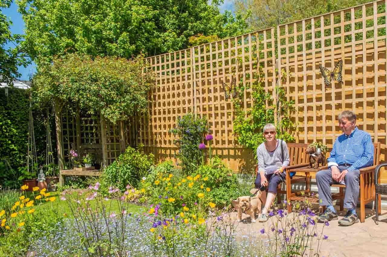 2. Gill and Andy: Little Bo and his owners enjoy a rest and a view of the garden