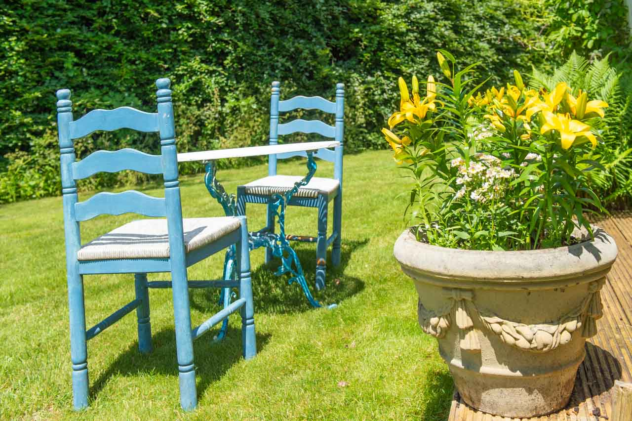 3. Julian and Jen: Yellow lillies and blue chairs make an inviting spot in the garden