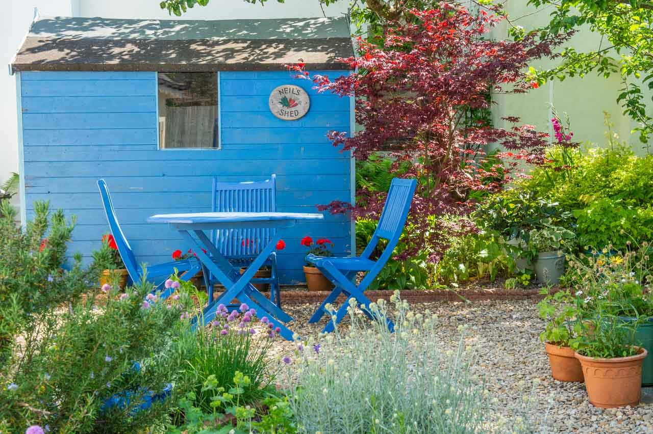 7. Roma and Neil: Neil's shed provides the perfect background to Roma's Herb garden
