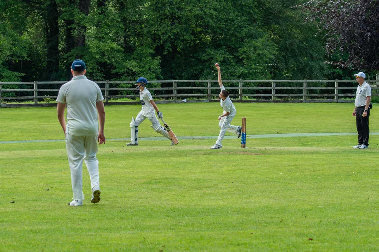 Ollie bowling from the Church end
