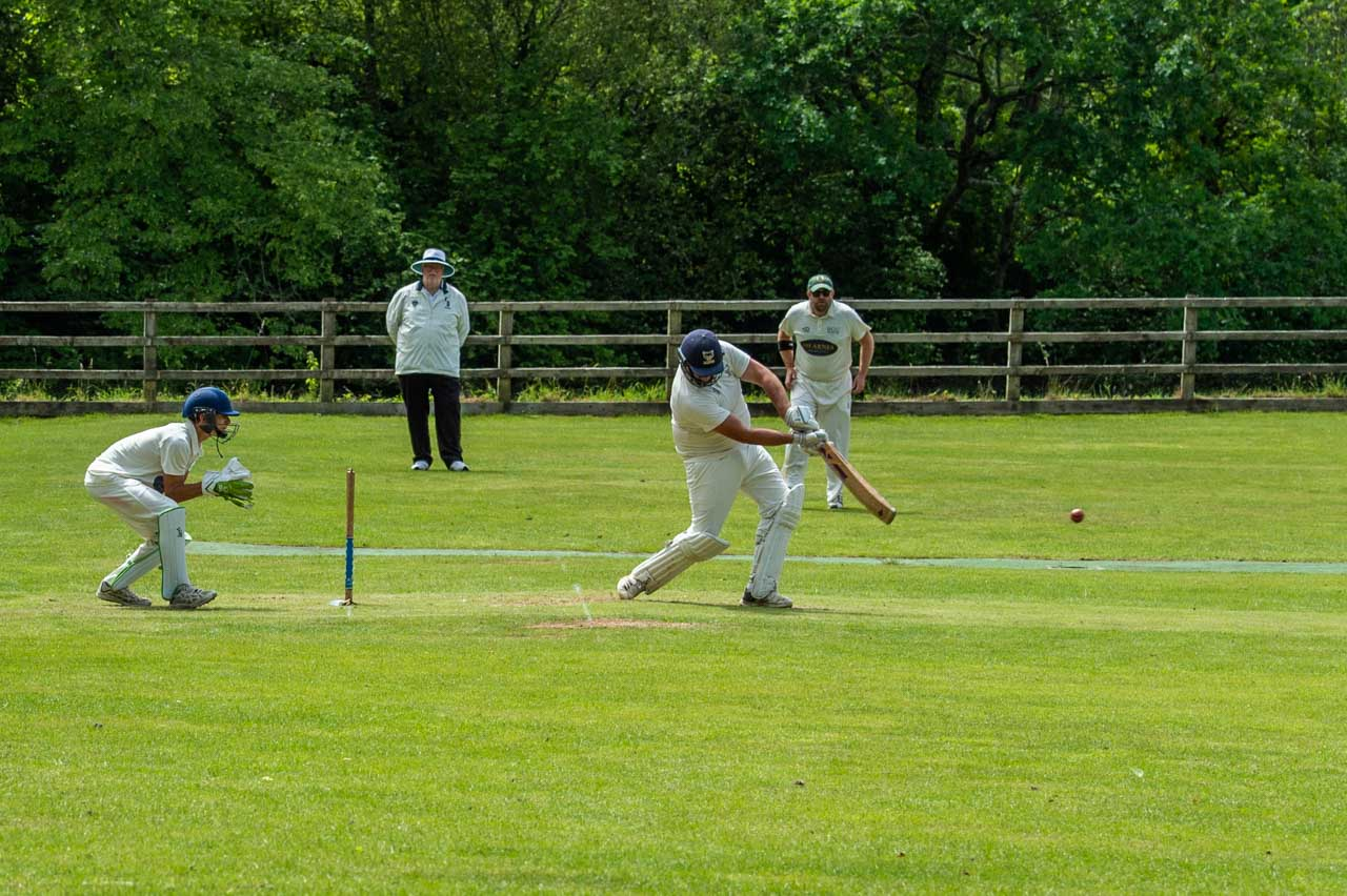 Brad driving a ball through the on side