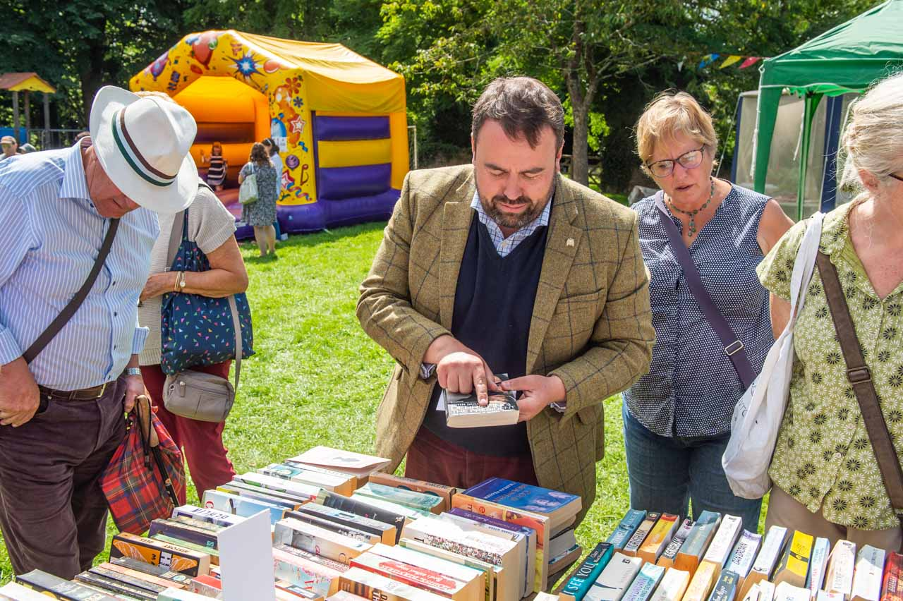 Customers, including local MP Chris Loder, enjoy browsing the many books on sale