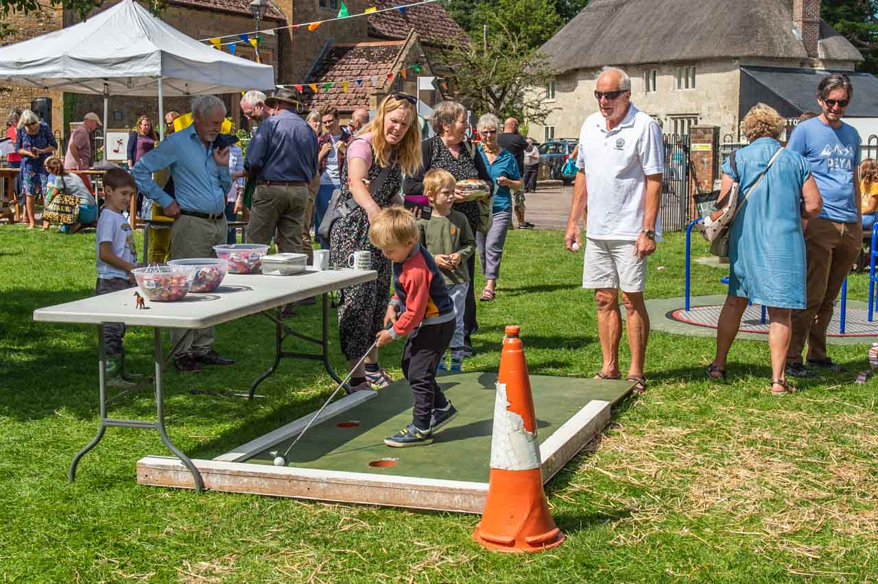A young visitor to Peter's golf game is determined to hole that ball