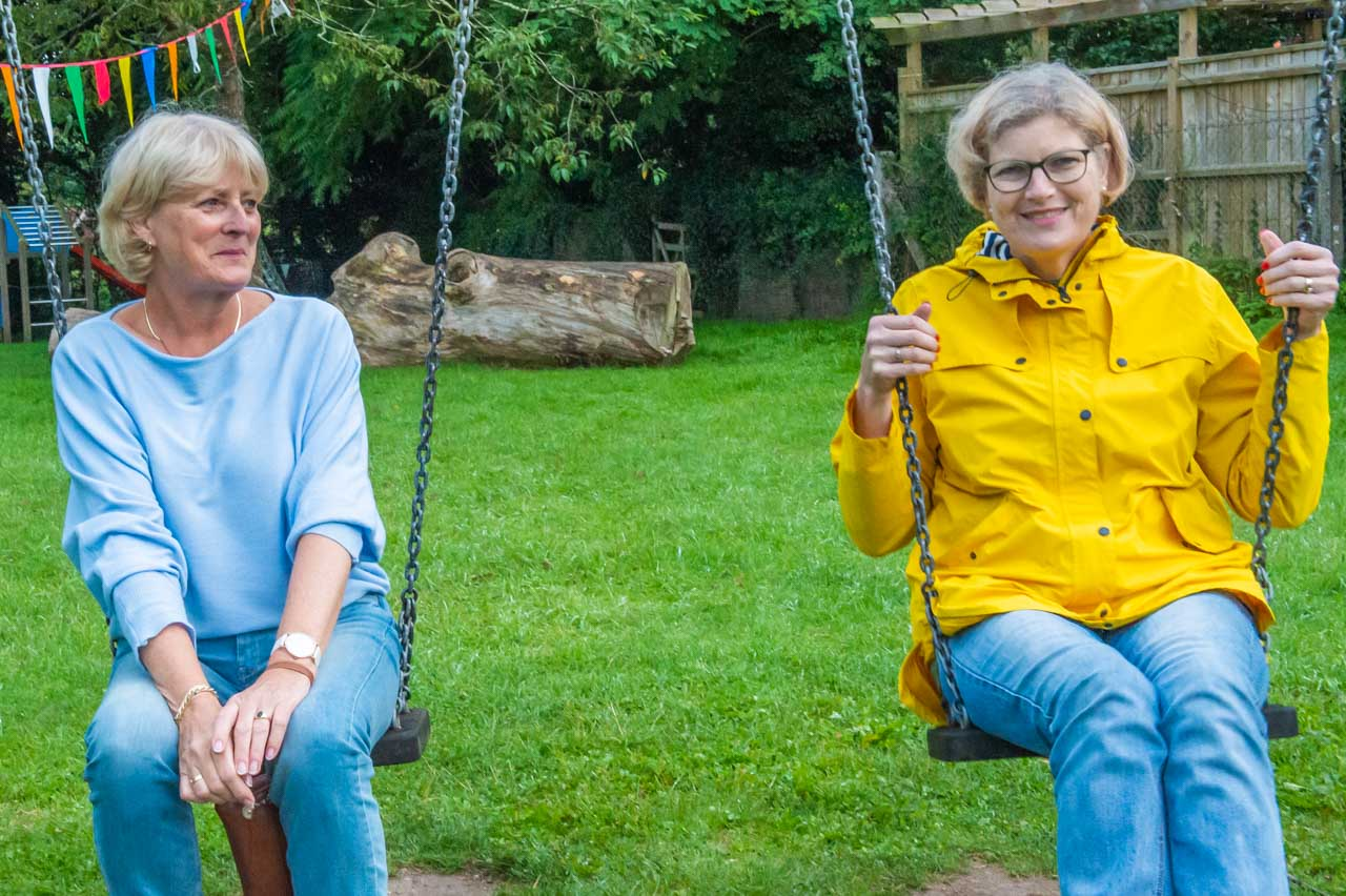 Liz through the lens: Ellen and Monique take time out for a swing