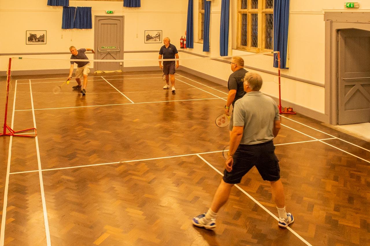 Men's doubles and Simon retrieves to James
